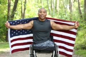 disabled veteran and american flag